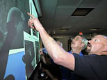 NASA staff look at photos downloaded from Phoenix Mars Lander (Reuters)