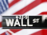 A Wall St. sign is seen outside the New York Stock Exchange September 30, 2008. (Lucas Jackson/Reuters)