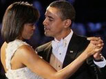 President Barack Obama, right, and first lady Michelle Obama dance together at the Neighborhood Inaugural Ballin Washington, Tuesday, Jan. 20, 2009. (AP Photo/Elise Amendola