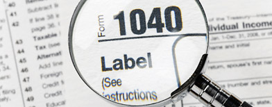 Magnifying glass over U.S. tax form (Getty Images)