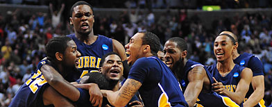 Murray State Racers celebrate after forward Danero Thomas (center) made the game-winning shot. (Kyle Terada-US PRESSWIRE)