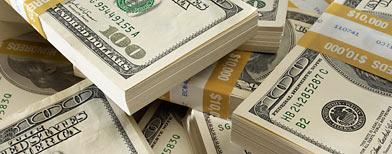 Bundles of hundred-dollar bills (Corbis)