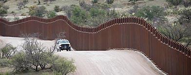 A  Customs and Border Patrol agent patrols along the international border  in Nogales, Ariz., Thursday, April 22, 2010. (AP Photo/Matt York)