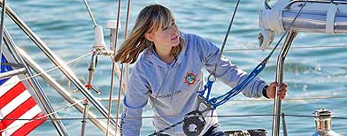 Abby Sunderland, 16, looks out from her sailboat, Wild Eyes, as she leaves for her world record attempting journey at the Del Rey Yacht Club, Saturday, Jan 23, 2010, in Marina del Rey, Calif. (AP)