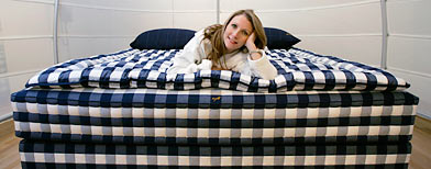Mary Pat Wallace, owner of Hastens' Chicago, poses on the Vividus ultra-luxe bed that retails for $49,500 (AP Photo/Charles Rex Arbogast)