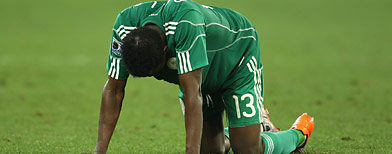 Yussuf Ayila of Nigeria is dejected after a draw and elimination in the 2010 FIFA World Cup South Africa Group B match between Nigeria and South Korea at Durban Stadium on June 22, 2010 in Durban, South Africa. (Photo by Steve Haag/Getty Images)