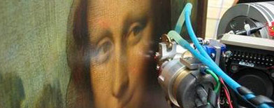 This recent undated photo provided Friday July 23, 2010, by the CNRS (National Center of Scientific Research) shows the Mona Lisa painting being examined with a non-invasive technique called X-ray fluorescence spectroscopy to study the thickness of paint layers and their chemical composition. (AP Photo/V.A Sol/ESRF)