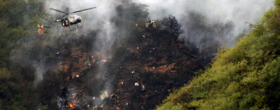 The smoldering wreckage of a passenger plane which crashed in the Margalla Hills (Reuters)