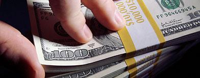 Stacks of Hundred Dollar Bills (ThinkStock)