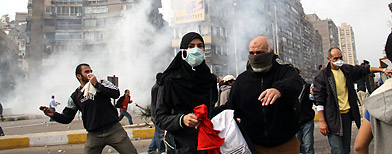 Egyptian protesters flee as riot police fire tear gas in Cairo, Egypt, Friday, Jan. 28, 2011. (Ahmed Ali/AP Photo)