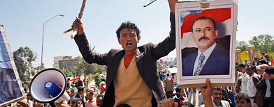 Supporters of the Yemeni government shout slogans as they try to enter Sanaa University where anti-government protestors gather. (AP Photo/Hani Mohammed)