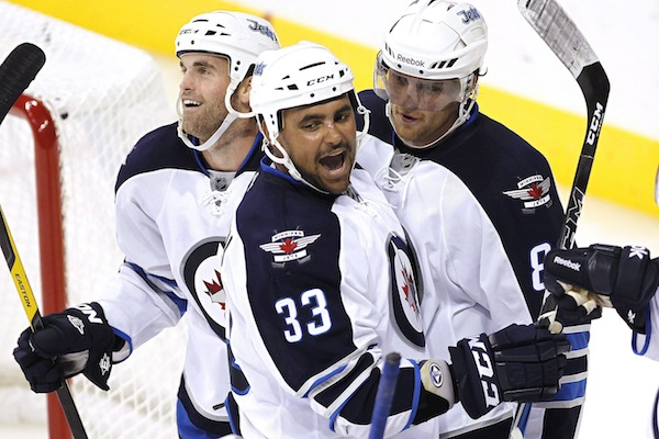 Andrew Ladd, Dustin Byfuglien return to Chicago for 1st time
