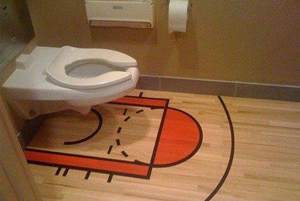 Somebody has an NBA-themed washroom floor because it's completely appropriate