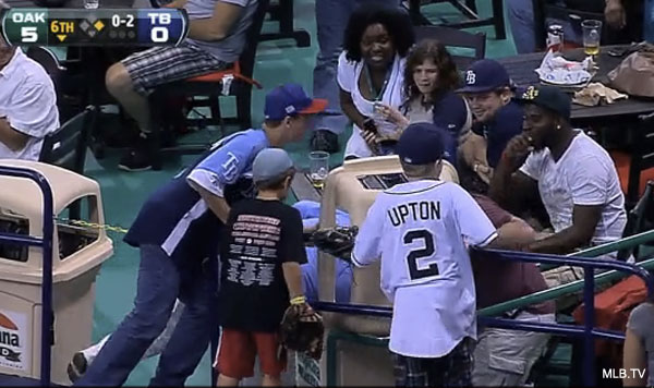 Rays fans dig through garbage after foul ball lands in can