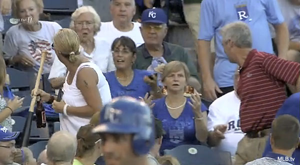 Video: Woman's funny reaction to losing battle over bat