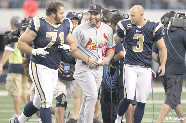 Create-a-Caption: Lance Berkman lends the Rams a hand