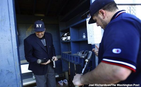 Virginia baseball umpires inspect a composite bat