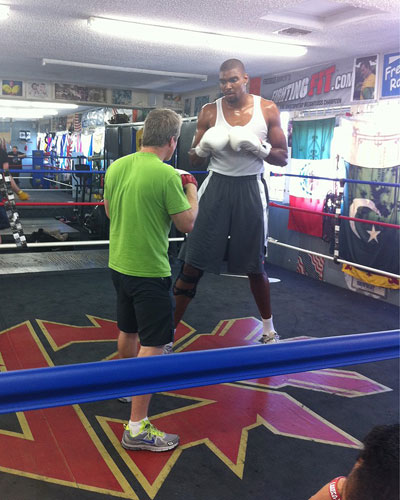 Andrew Bynum enjoys a nice afternoon in the gym, getting hit