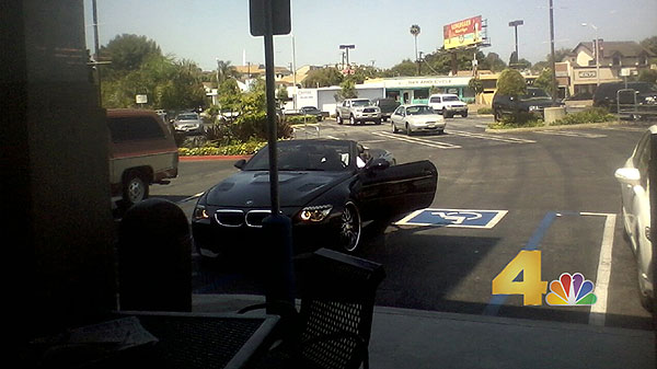 Andrew Bynum parked in a handicapped spot. Come on, Andrew Bynum