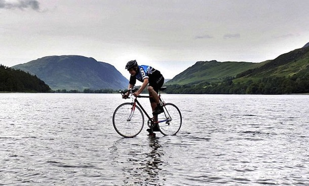 British teenager bikes on top of water for charity, won't say how