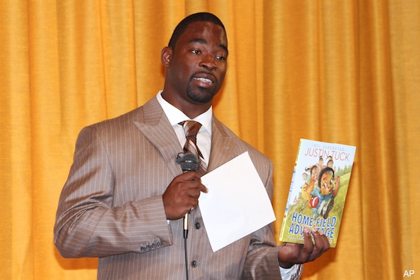 Justin Tuck wrote a kids' book about growing up with five sisters