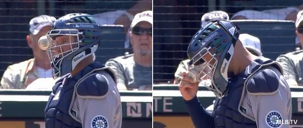 Wedgie! Foul ball sticks in mask of Mariners catcher Josh Bard