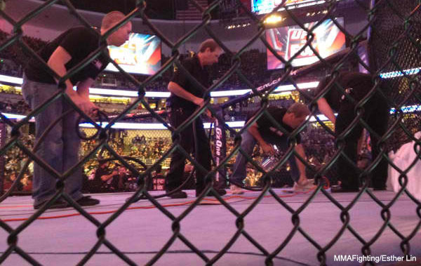 UFC staffers paint over blood in Octagon to ready for network TV