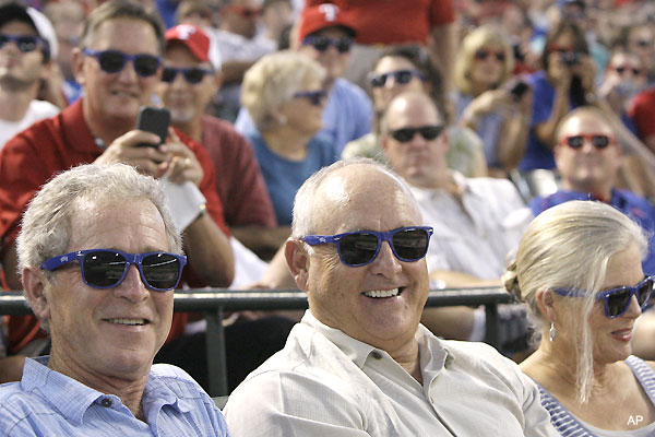 George Bush and Nolan Ryan get themselves some cheap sunglasses