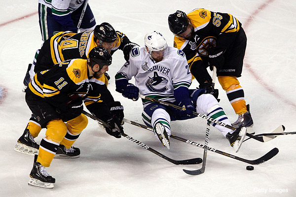 Canucks try to fix power play, end Bruins' chippy play