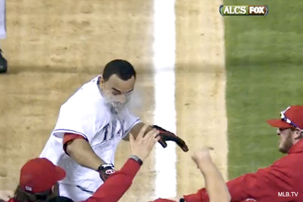 Photo: Nelson Cruz gets a wet and wild welcome at home plate