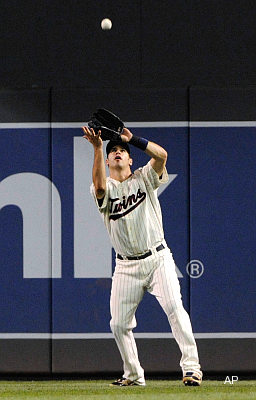 Hughes misses flight to Minnesota, forces Mauer to play outfield