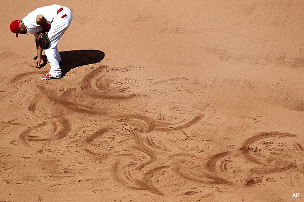 Create-a-Caption: Albert Pujols gets artistic at first