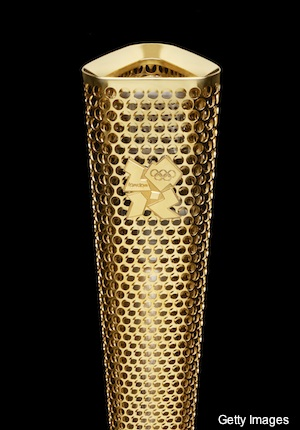 Photos: London unveils traditional torch for next year's Olympics