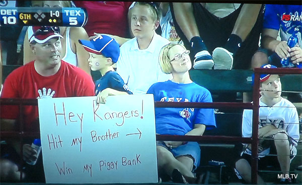 Photo: Young Rangers fan places bounty on brother's head