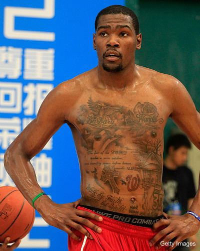 Kevin Durant has a lot of tattoos under his jersey