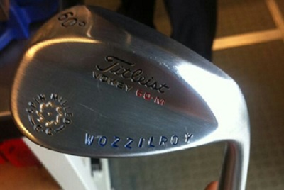 Rory McIlroy gives Caroline Wozniacki a distinctive golf club