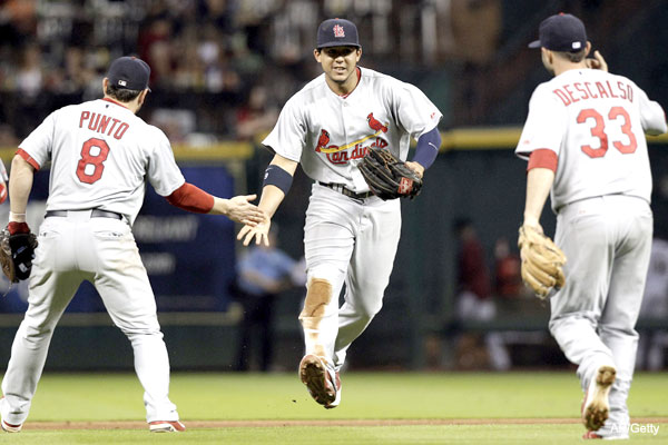 They're in! Cards seize NL wild card as Braves collapse