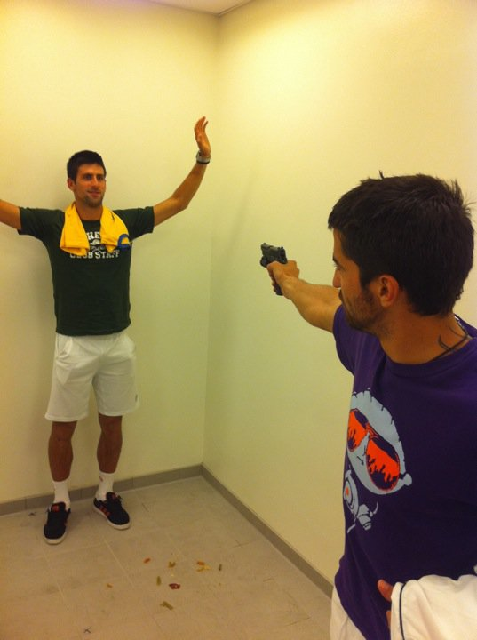 Photo: Novak Djokovic jokes around with a gun pointed at him