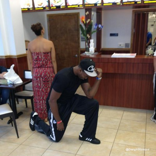 "Photo:  Dwight Howard Jumps on the ""Tebowing"" Bandwagon While Ordering Food at a Chinese Restaurant"