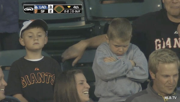 U mad bro?: Young Giants fan pouts big time over foul ball