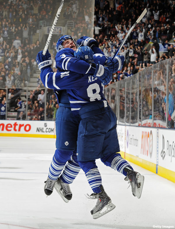 IMAGE(http://l.yimg.com/a/p/sp/editorial_image/d7/d71f06e7efc6f6750f1ce0401a210fff/hockey_hugs_dion_loves_phil_happy_blues_and_holy_getzlaf.jpg)