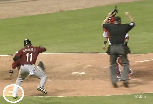 Strange turn: Jay's errant throw hits on-deck batter Bourgeois