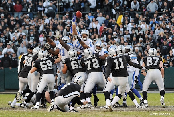 Janikowski misses 65-yard FG; would have won game, set record