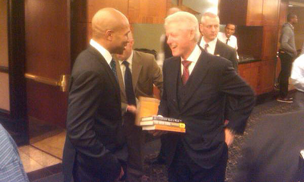 Bill Clinton sides with labor, and has a gift for Derek Fisher