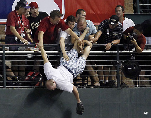 Josh Hamilton accidentally kills fan! Fan_almost_falls_from_chase_field_stands_at_home_run_derby