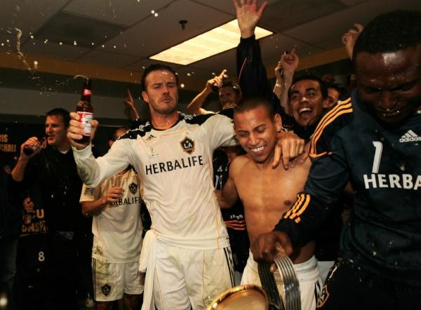 Beckham gets a little teary, celebrates MLS Cup with a Budweiser