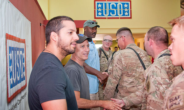 Photo: David Blaine, Jon Stewart, and Karl Malone greet the troops