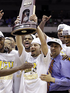Joey Rodriguez (holding trophy) and VCU didn't back down when challenged by the No. 1 seed.