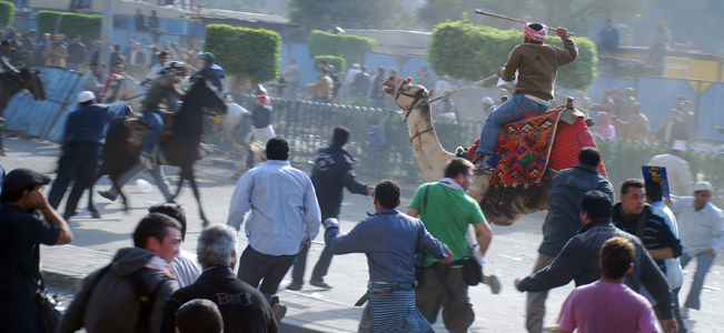 Supporters of President Hosni Mubarak, riding camels and horses, fight with anti-Mubarak protesters in Cairo, Egypt