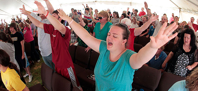 Brianne Knowles prays during a church service in Hackleburg, Ala.,